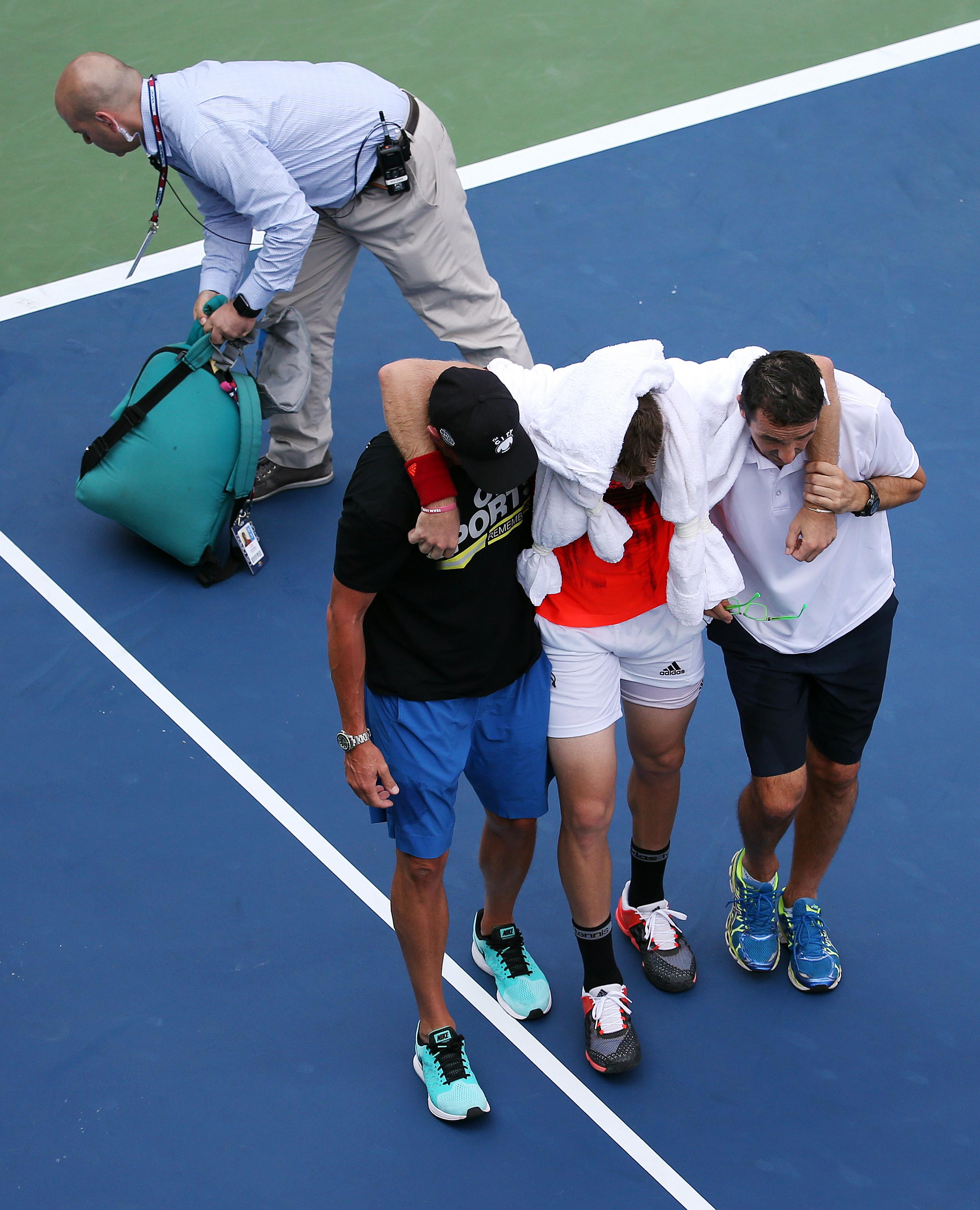 American Jack Sock has to be carried off court