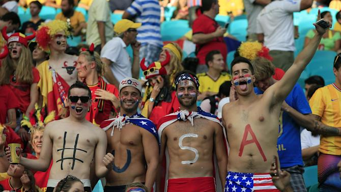 US supporters cheer ahead of their World Cup match against Belgium at The Fonte Nova Arena in Salvador on July 1, 2014