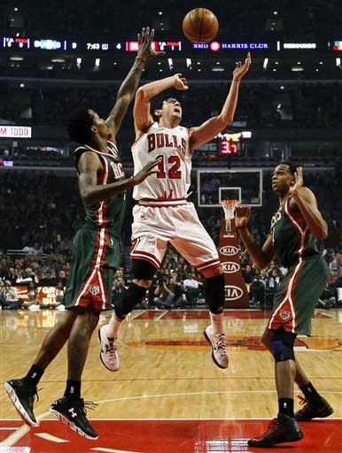 Bucks rally from 27-point hole to stun Bulls 93-92