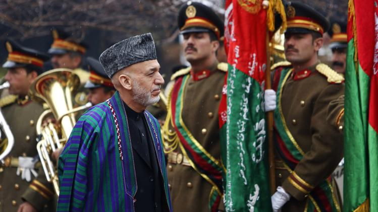 Afghanistan's President Hamid Karzai arrives at the opening ceremony of the fourth year of the Afghanistan parliament in Kabul