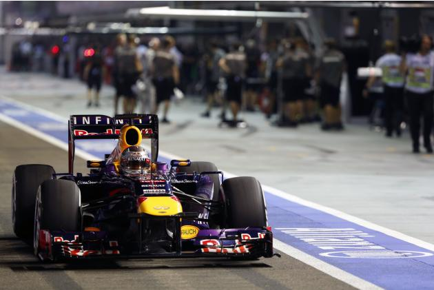 Red Bull Formula One driver Vettel drives in the pit lane during the qualifying session of the Singapore Formula One Grand Prix