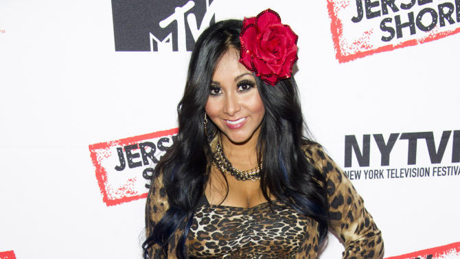 "FILE - In this Oct. 24, 2012 file photo, Jersey Shore cast member Nicole ""Snooki"" Polizzi attends a panel entitled ""Love, Loss, (Gym, Tan) and Laundry: A Farewell to the Jersey Shore,"" in New York. MTV says ""Jersey Shore"" stars Nicole ""Snooki"" Polizzi and Jenni ""JWOWW"" Farley and comedian Jeff Dye will host the network's live New Year's Eve special, ""MTV's Club NYE 2013,"" from Times Square. (Photo by Charles Sykes/Invision/AP, File)"