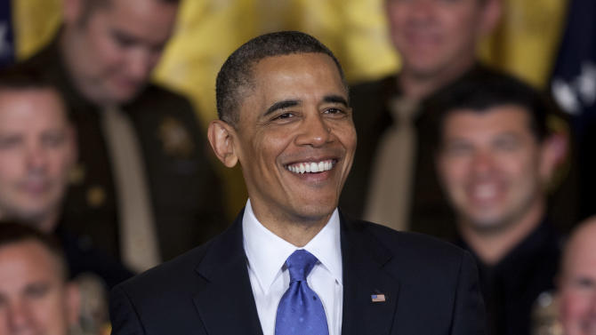 President Barack Obama smiles during remarks at an event to honor the 2013 National Association of Police Organizations TOP COPS award winners in the East Room of the White House on Saturday, May 11, 2013, in Washington. (AP Photo/Evan Vucci)