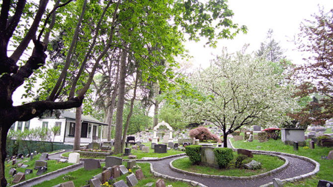 """This 2011 photo provided by the Hartsdale Pet Cemetery in Whtie Plains, N.Y., shows a scenic view of the first burial ground for animals named to the National Register of Historic Places. The 116-year-old Hartsdale Pet Cemetery, final home to some 75,000 animals and a few hundred humans, is being designated for its """"social history and landscape architecture."""" (AP Photo/Hartsdale Pet Cemetery, Mary Thurston)"""