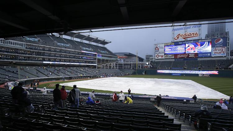 The tarp rests on the field before a baseball game between the New York Yankees and the Cleveland Indians, Wednesday, April 10, 2013, in Cleveland. (AP Photo/Tony Dejak)