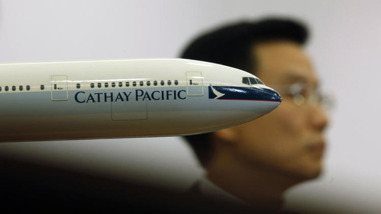 Cathay crew threaten no smiles, booze on flights