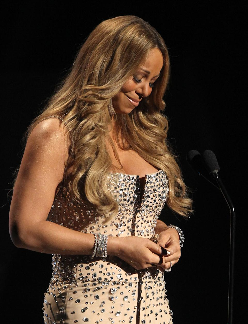 Mariah Carey pauses as makes an address during the in memoriam to Whitney Houston at the BET Awards on Sunday, July 1, 2012, in Los Angeles. (Photo by Matt Sayles/Invision/AP)