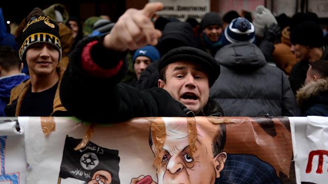 A protester shouts slogans during a demonstration in front of the Turkish embassy in Moscow on November 25, 2015