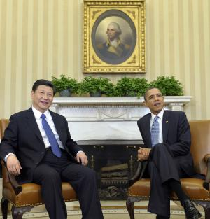 FILE - In this file photo taken Tuesday, Feb. 14, 2012, Chinese Vice President Xi Jinping, left, meets with President Barack Obama in the Oval Office of the White House in Washington. Chinese have long been fascinated with U.S. presidential elections, but interest is particularly high this year because Americans are voting at the same time Beijing is going through its own political transition. (AP Photo/Susan Walsh, File)