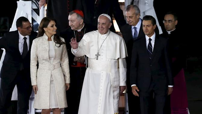 Pope Francis walks with Mexico's first lady Rivera and President Pena Nieto after his arrival in Mexico City