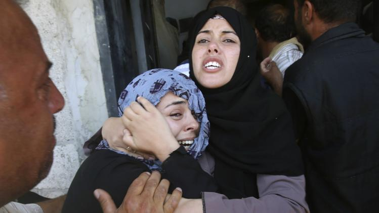Relatives of three Palestinian members of Abu Muamar family, who hospital officials said were killed in an Israeli air strike on their house, mourn during their funeral in Rafah in the southern Gaza Strip