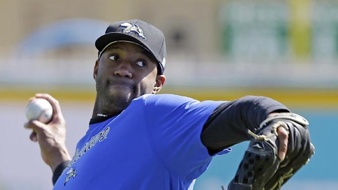 Retired NBA All-Star Tracy McGrady throws a pitch at the Sugar Land Skeeters baseball stadium Wednesday, Feb. 12, 2014, in Sugar Land, Texas. McGrady hopes to tryout as a pitcher for the independent Atlantic League Skeeters