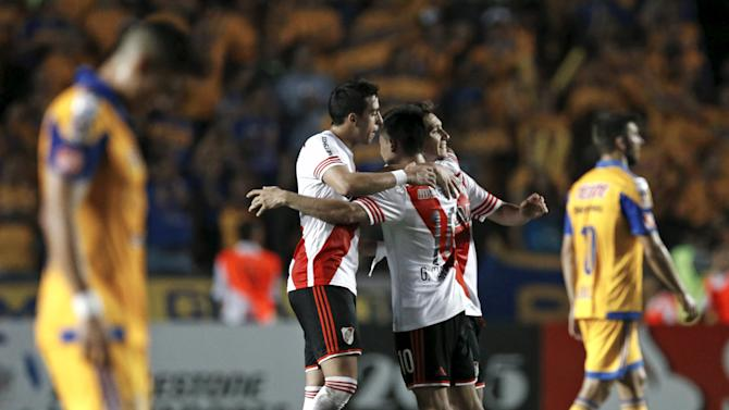 Players of Argentina's River Plate embrace after the first leg of their Copa Libertadores final soccer match against Mexico's Tigres at the Universitario stadium in Monterrey
