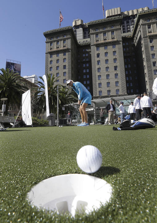 IMAGE DISTRIBUTED FOR TAYLORMADE GOLF - LPGA pro Anna Nordqvist, from Sweden, sinks a putt on a constructed putting green in the middle of Union Square at the TaylorMade Speed Pocket Challenge, on Tue