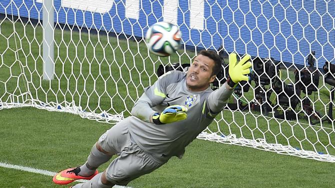 Brazil's goalkeeper Julio Cesar saves a shot by Chile's defender Gonzalo Jara during the penalty shoot out after extra-time in the World Cup match between Brazil and Chile in Belo Horizonte on June 28, 2014