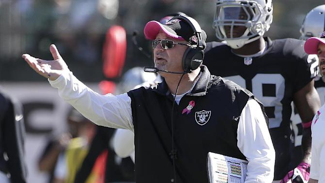In this Oct. 12, 2014, file photo, Oakland Raiders interim head coach Tony Sparano gestures from the sideline during the second quarter of an NFL football game against the San Diego Chargers in Oakland, Calif
