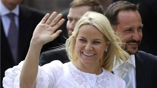 FILE- Norwegian Crown Pricess Mette-Marit and her husband Crown Prince Haakon Magnus, right, wave to the waiting crowd in Stralsund, northern Germany, in this file photo dated Saturday, June 12, 2010.  When friends of Norway's Crown Princess Mette-Marit couldn't travel to India to welcome their surrogate twins into the world, Crown Princess Mette-Marit stepped in and flew to India to look after the twins until the two fathers could fly out, according to Royal Court spokeswoman Marianne Hagen on Monday Dec. 3, 2012,  minding the couple's newly born children and being mistaken by hospital staff for a nanny.  The princess flew to Delhi on Oct. 23, 2012, after visa problems prevented the children's Norwegian parents from arriving at the hospital in time for the birth.(AP Photo/ddp/Michael Urban, File)