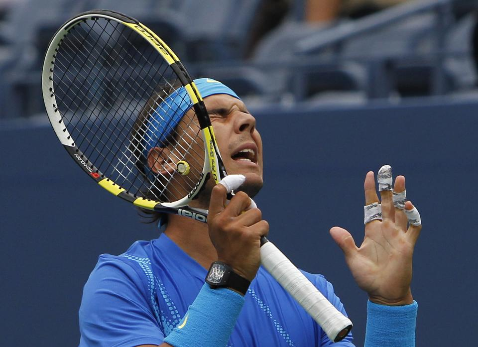 Rafael Nadal of Spain reacts during his match against Gilles Muller of Luxembourg during the U.S. Open tennis tournament in New York, Wednesday, Sept. 7, 2011. (AP Photo/Mike Groll)