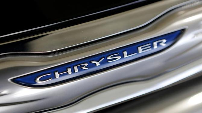 The Chrysler logo is shown on a new Chrysler 200 on the showroom at the Massey-Yardley Chrysler, Dodge, Jeep and Ram automobile dealership in Plantation
