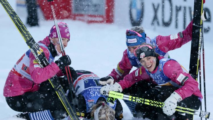 Jessica Diggins and team USA celebrate coming in third-placed in the women's 4x5 km relay during the FIS Cross-Country World Cup in Lillehammer