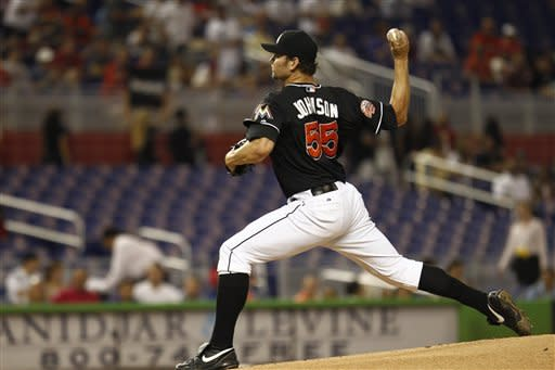 Johnson leads Marlins past Lee, Phillies 6-2
