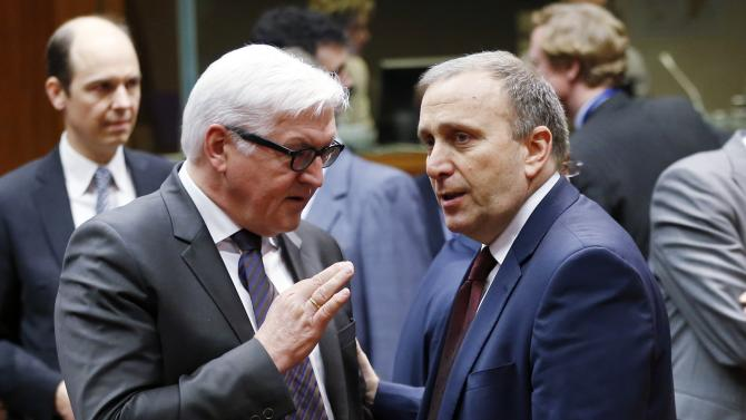 German Foreign Minister Steinmeier talks to his Polish counterpart Schetyna during an extraordinary European Union foreign ministers meeting in Brussels