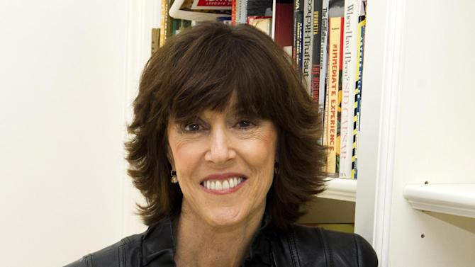 """FILE - This Nov. 3, 2010 file photo shows author, screenwriter and director Nora Ephron at her home in New York.  The Tribeca Film Festival has created a new award for female filmmakers named after the late Nora Ephron.  Tribeca announced the prize Tuesday, April 16, 2013, on the eve of its 12th annual festival. The award will be presented to a woman writer or director, the festival said, """"who embodies the spirit and vision of the legendary filmmaker and writer."""" (AP Photo/Charles Sykes, file)"""