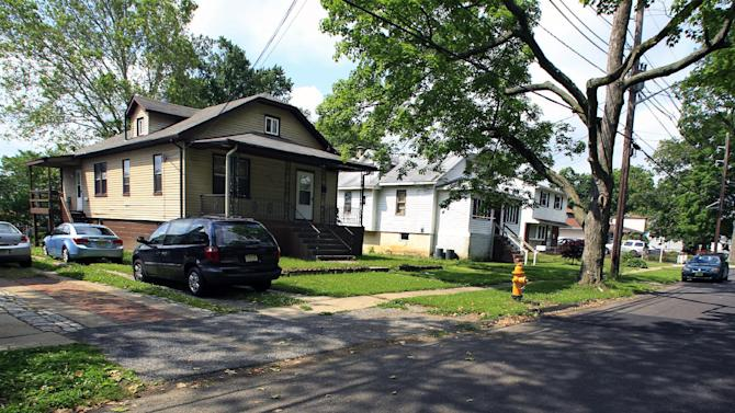 A house, left, at 116 E. Linwood Ave., is seen in Maple Shade, N.J., Thursday, May 24, 2012. A woman who would not identify herself, answered the door at Apt. B, door left, back of house, and said that it is the home of Pedro Hernandez, who is in custody in the disappearance of Etan Patz in 1979. Hernandez has implicated himself in the death of Patz, police said Thursday. (AP Photo/Mel Evans)