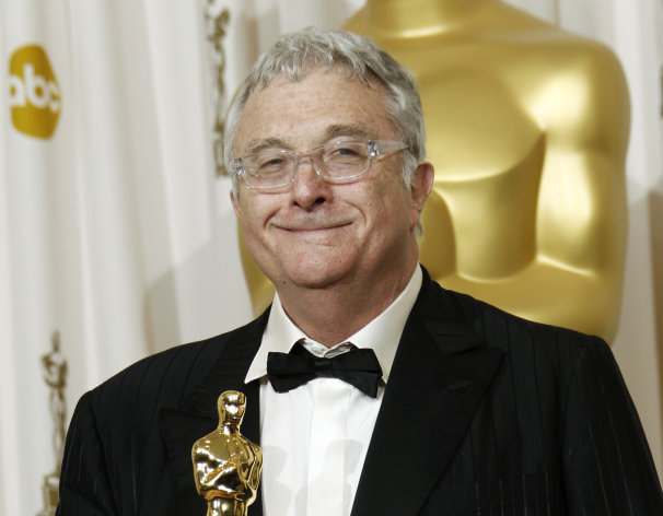 FILE - This Feb. 27, 2011 file photo shows composer Randy Newman posing backstage with the Oscar for best original song for We Belong Together&quot; from Toy Story 3&quot; at the 83rd Academy Awards in the Hollywood section of Los Angeles. Newman is weighing in on the presidential election, and he&#39;s playing the race card through a song he wrote. Im Dreaming is full of satirical, sarcastic _ and signature Newman _ anecdotes about someone who votes for the president because he is white. It features the refrain: Im dreaming of a white president. Newman is openly supporting President Barack Obama. He says though the song is serious, he wants the public to find comedic relief in it.(AP Photo/Matt Sayles, File)