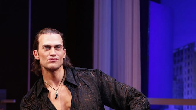 "This theater image released by Sam Rudy Media Relations shows Cheyenne Jackson during a performance of ""The Performers,"" in New York. (AP Photo/Sam Rudy Media Relations, Carol Rosegg)"