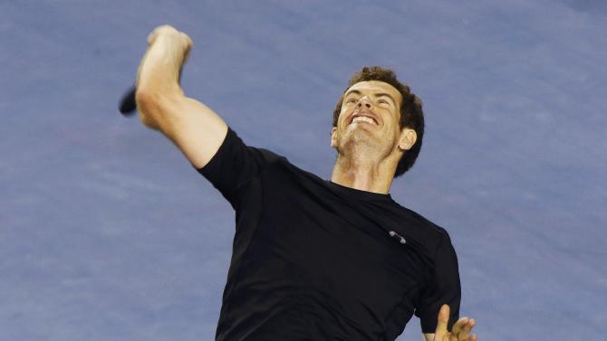 Murray of Britain throws his sweat band to the crowd after defeating Berdych of Czech Republic to win their men's singles semi-final match at the Australian Open 2015 tennis tournament in Melbourne