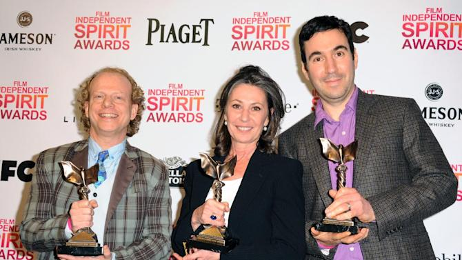 """Producers Bruce Cohen, left, Donna Gigliotti, and Jonathan Gordon, right, pose backstage with the award for best feature for """"Silver Linings Playbook"""" at the Independent Spirit Awards on Saturday, Feb. 23, 2013, in Santa Monica, Calif.  (Photo by Jordan Strauss/Invision/AP)"""