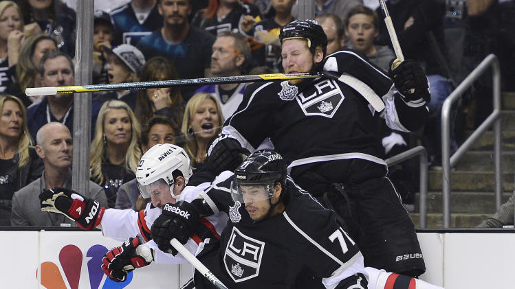 New Jersey Devils center Ryan Carter (20) collides with Los Angeles Kings center Jordan Nolan (71) and Los Angeles Kings defenseman Matt Greene (2) in the first period during Game 6 of the NHL hockey Stanley Cup finals,Monday, June 11, 2012, in Los Angeles.  (AP Photo/Mark J. Terrill)