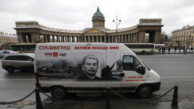 "A bus decorated with a portrait of Soviet dictator Josef Stalin and a sign reading ""Stalingrad gets back its victorious name"" rides in front of  the Kazansky Cathedral in St. Petersburg, Russia, Saturday, Feb. 2, 2013. On Saturday Russia marked the 70th anniversary of the end of  the battle of Stalingrad. The city was renamed Volgograd in 1961, but the name Stalingrad is indelibly connected with the battle that is one of Russia's most-lauded military achievements. Stalin's image adorns five buses that are to run in Volograd until Russia observes Victory Day on May 9, and similar buses were to run Saturday in St. Petersburg and Chita. (AP Photo/Elena Ignatyeva)"