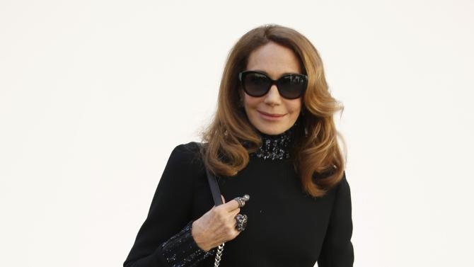Actress Marisa Berenson poses before French fashion house Christian Dior Autumn/Winter 2015/2016 women's ready-to-wear collection show during Paris Fashion Week