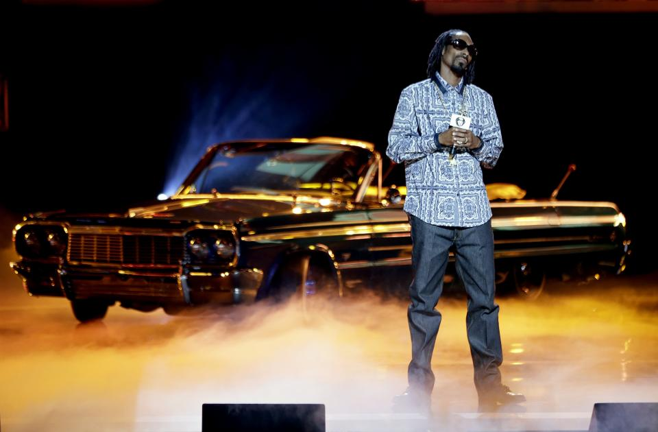 Rapper Snoop Dogg takes the stage to host the BET Hip Hop Awards, Saturday, Sept. 28, 2013, in Atlanta. (AP Photo/David Goldman)