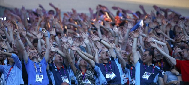 "Spectators participate in a ""wave"" during the closing ceremony of the London 2012 Olympic Games at the Olympic Stadium"