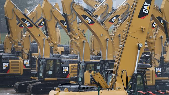 Excavators are parked at the parking lot of Caterpillar Belgium, in Gosselies, Belgium, Thursday, Feb. 28, 2013. Construction equipment maker Caterpillar says it will cut more than one in three jobs at its Belgium plant, because of high labor costs and sluggish growth in its European market. (AP Photo/Yves Logghe)