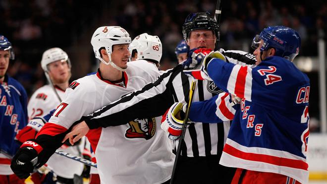Linesman Scott Driscoll #68 Breaks Up A Fight Against Filip Kuba #17 Of The Ottawa Senators And Ryan Callahan #24 Of Getty Images