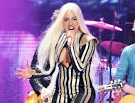 "FILE - This Dec. 15, 2012 file photo shows singer Lady Gaga performing at the Prudential Center in Newark, N.J. Lady Gaga's manager said in an interview Tuesday, March 19, 2013, that the singer is ""doing wonderful, doing great,"" after undergoing hip surgery. Gaga canceled her ""Born This Way Ball"" tour last month after she'd hurt herself while performing some time ago. (Photo by Evan Agostini/Invision/AP, file)"