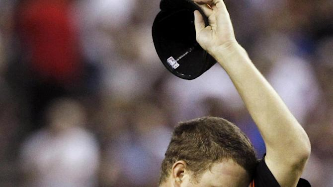 San Francisco Giants' Matt Cain wipes his face after giving up a run-scoring double in the seventh inning of an MLB baseball game against the San Francisco Giants, Friday, Sept. 23, 2011, in Phoenix. The Diamondbacks defeated the Giants 3-1 and won the 2011 National League West Champions title. (AP Photo/Ross D. Franklin)