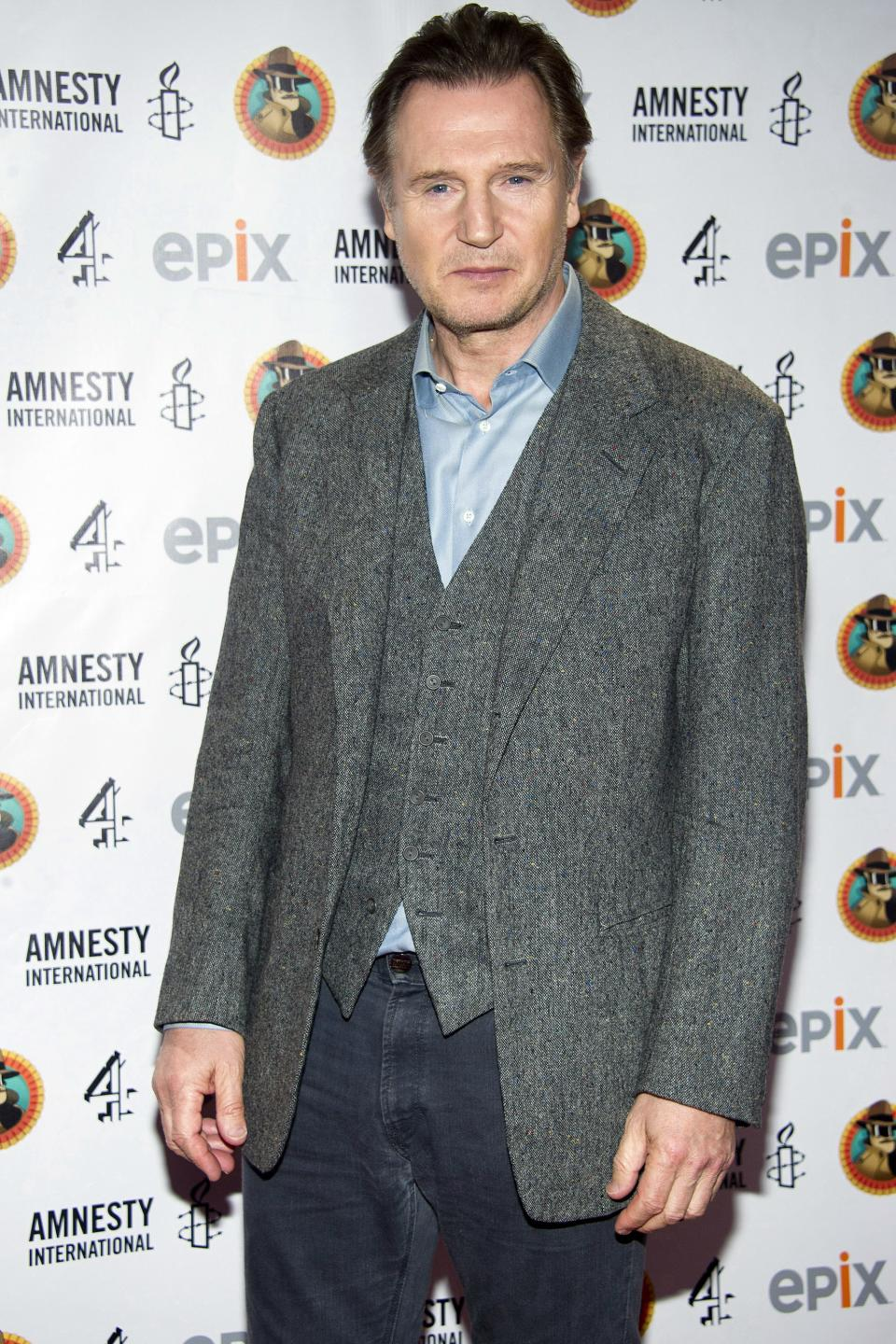 "Liam Neeson arrives to Amnesty International's ""Secret Policeman's Ball"" in New York, Sunday, March 4, 2012. (AP Photo/Charles Sykes)"
