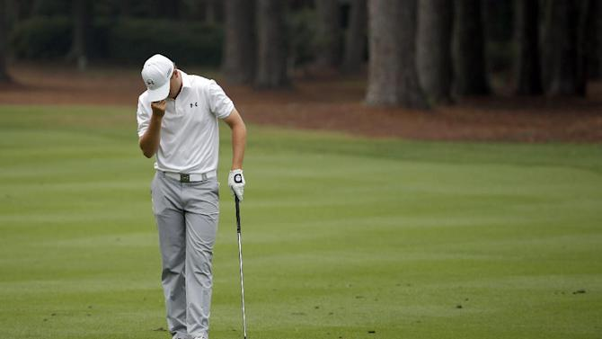 Jordan Spieth reacts after chipping in from the 11th fairway during the RBC Heritage golf tournament in Hilton Head Island, S.C., Sunday, April 19, 2015. (AP Photo/Stephen B. Morton)