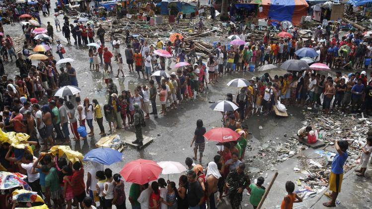 Victims queue for food and water in the aftermath of super typhoon Haiyan in Tacloban