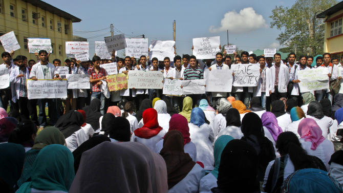 """Kashmiri medical students protest against an anti-Islam film called """"Innocence of Muslims"""" that ridicules Islam's Prophet Muhammad Wednesday, Sept. 19, 2012,  in Srinagar, India.  (AP Photo/Mukhtar Khan)"""