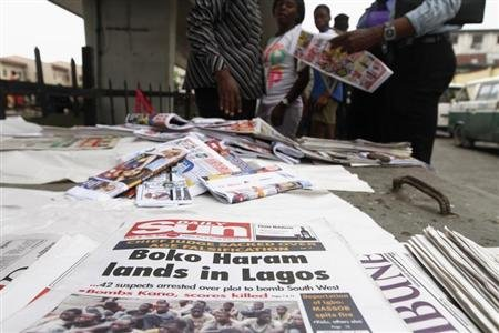 Newspapers are displayed at a vendor's stand along a road in Obalende district in Nigeria's commercial capital Lagos July 30, 2013. REUTERS/Akintunde Akinleye