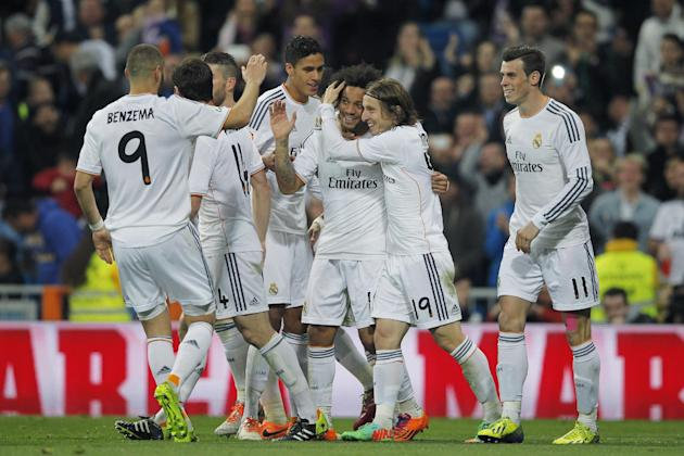 Real's Marcelo, centre, celebrates his goal with teammates during a Spanish La Liga soccer match between Real Madrid and Levante at the Santiago Bernabeu stadium in Madrid, Spain, Sunday, March 9,