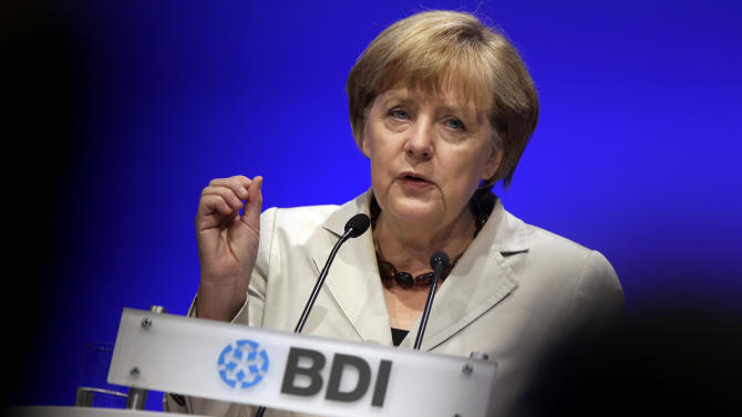 German Chancellor Angela Merkel speaks during a the annual meeting of the umbrella Association of German Industry, BDI, in Berlin, Germany, Tuesday, Sept. 25, 2012. (AP Photo/Michael Sohn)