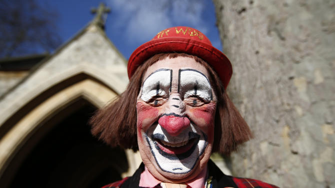 """The clown """"Mr. Woo"""" arrives at the All Saints Church before the Grimaldi clown service in Dalston, north London"""