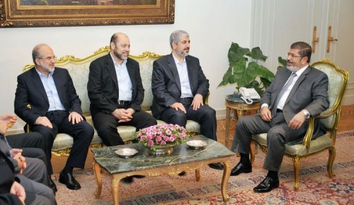 "A picture released by the Egyptian presidency shows Egyptian President Mohamed Morsi (R) meeting with Palestinian Hamas political bureau chief Khaled Meshaal (2nd R) at the presidential palace in Cairo. The head of the Hamas government Ismail Haniya hailed the meeting as the ""fruit of the revolution"" that ousted Hosni Mubarak"